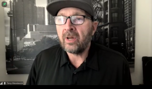 This is a screenshot of Tony Mandarich speaking at the event.